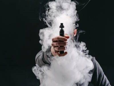 90499840 unrecognizable man in the cloud of vape smoke guy smoking e cigarette to quit tobacco vapor and alte thumb 400x300 - 【まとめ】【調査】全国喫煙本数 1位は愛媛県で1日平均約19本!最も少ないのは滋賀県8.7本 禁煙で「モテるようになった」人も