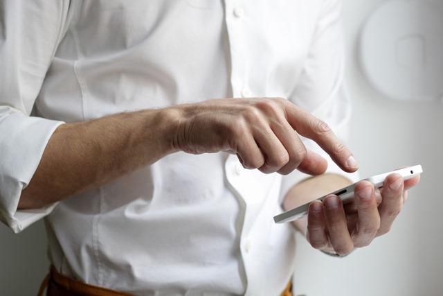man touching phone screen thumb - 【特集】ラインとは何か、そして監視はできるか?
